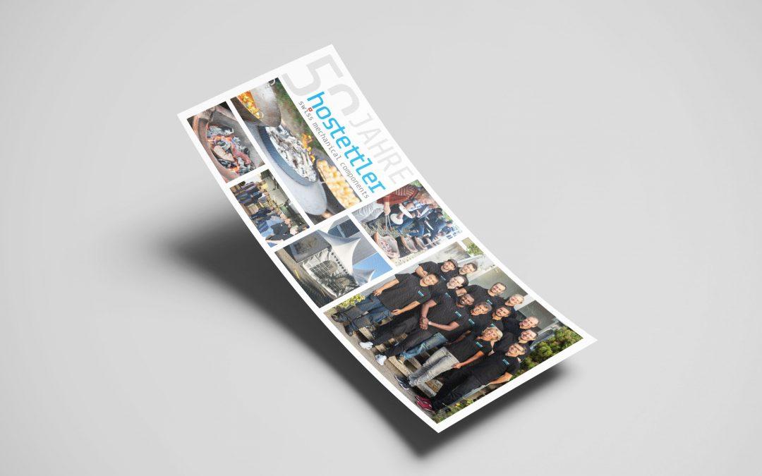 Postkarte Firmenjubiläum W. Hostettler AG